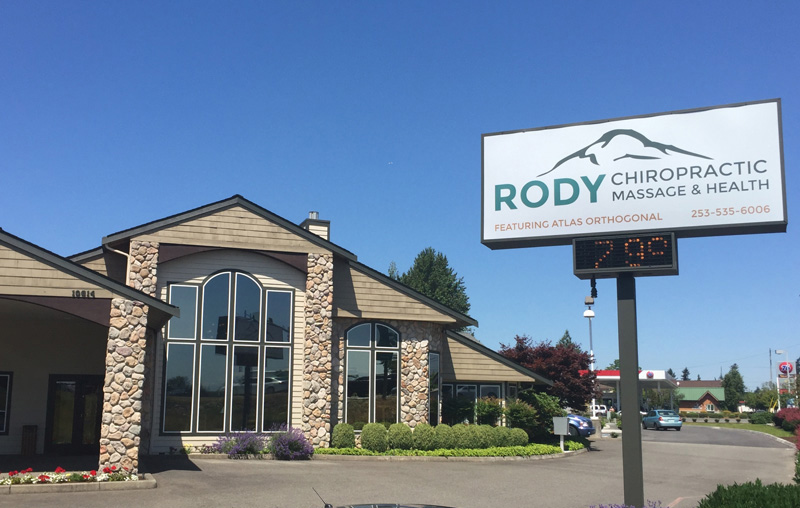 Exterior of Rody Massage building with sign.